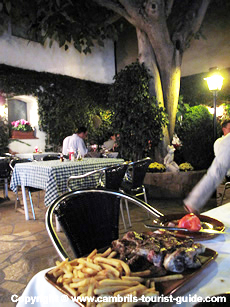 The courtyard dining at Les Palmeres